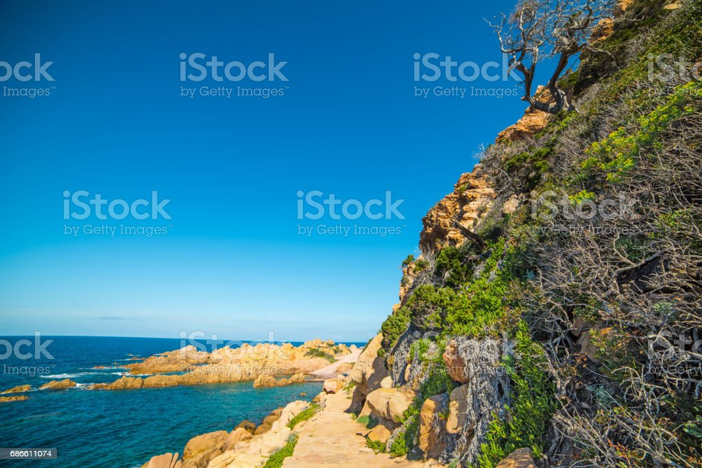 Cliff and path in Sardinia royalty-free stock photo
