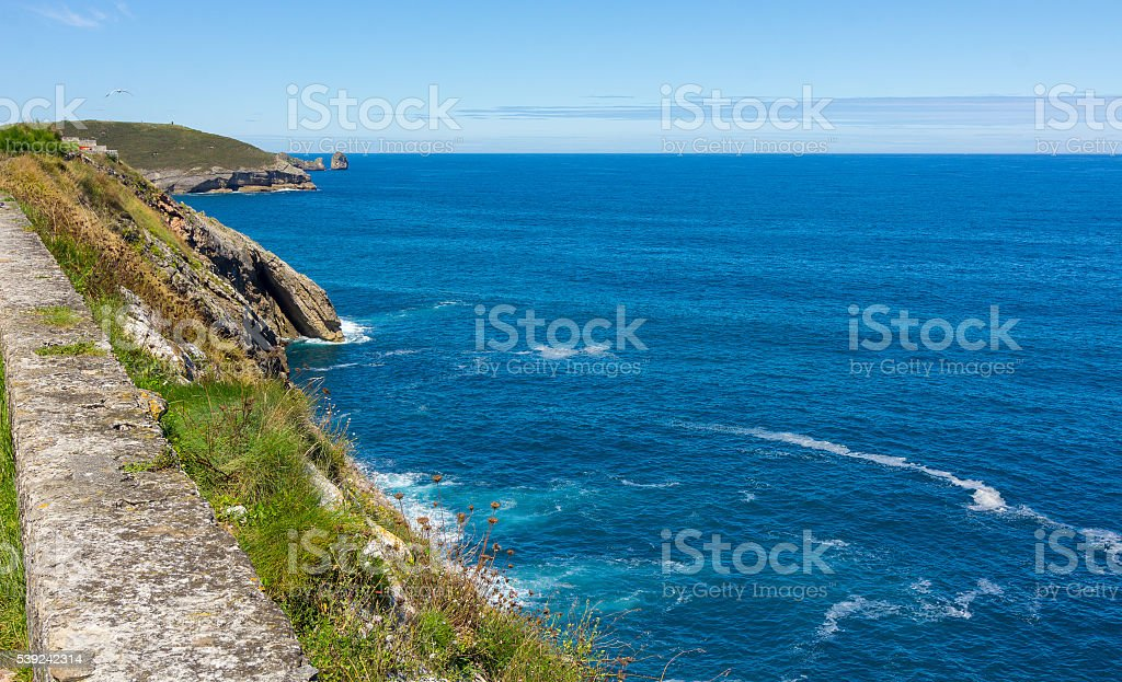 Cliff area in the resort town of Llanes, Spain royalty-free stock photo
