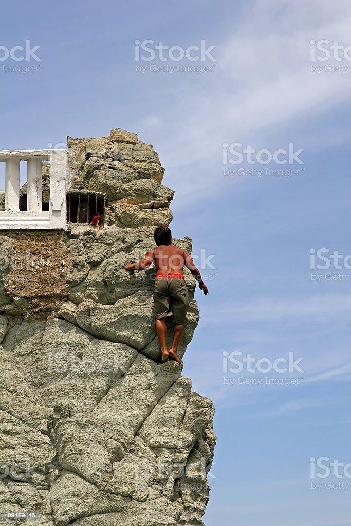 Cliff Diver Climbing royalty free stockfoto