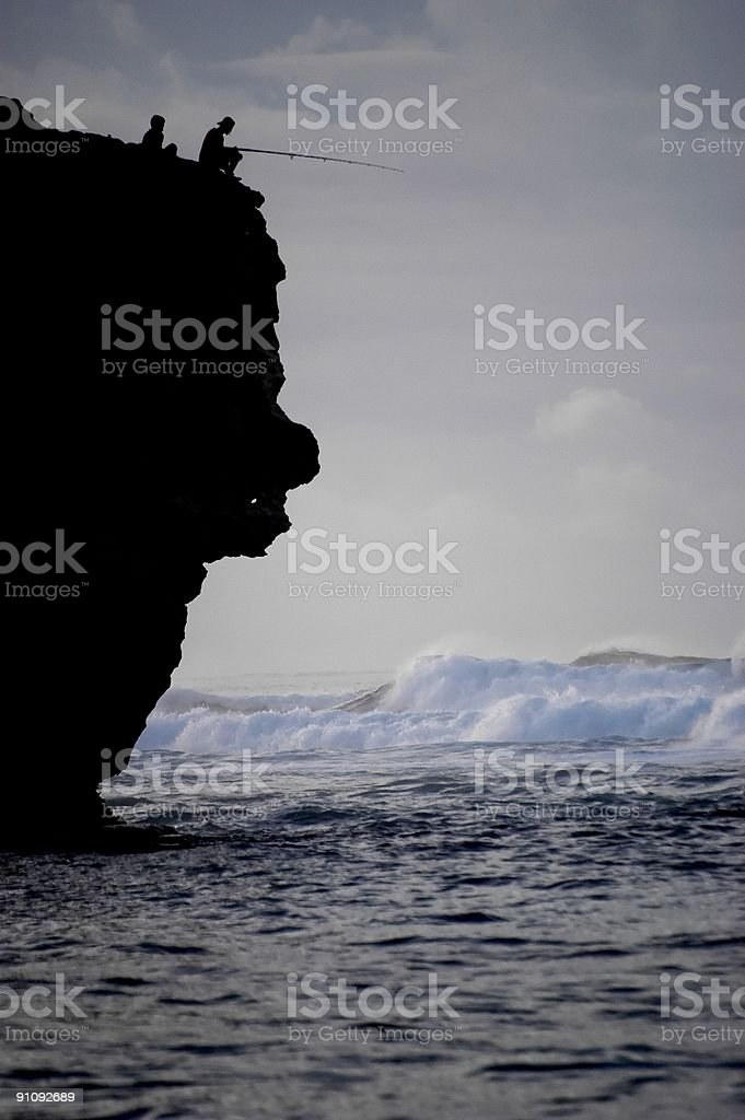 Cliff Fishing in Hawaii royalty-free stock photo