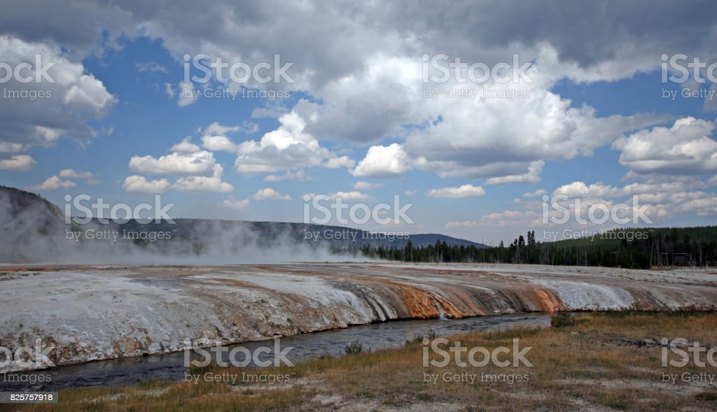 Cliff Geyser next to Iron Spring Creek in Black Sand Geyser Basin in Yellowstone National Park in Wyoming USA stock photo