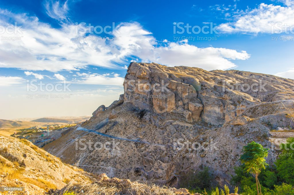 Cliff in front of blue sky stock photo