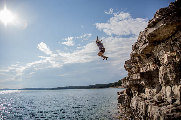 cliff jumping - daredevil stock pictures, royalty-free photos & images