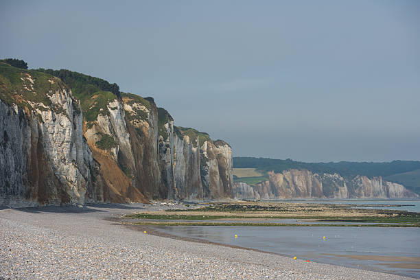 Cliff lined beaches of Normandy. France White chalky cliffs of Normandy in Northern France dieppe france stock pictures, royalty-free photos & images