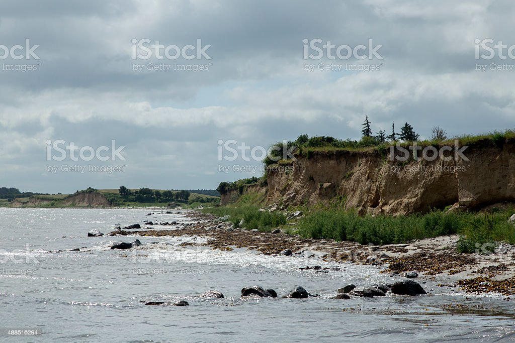 Cliff of boulder clay and beach stock photo