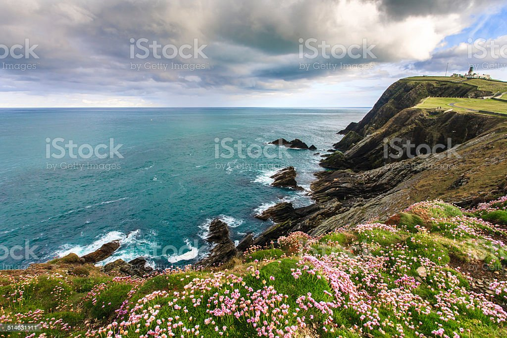 Cliff under cloudy sky stock photo