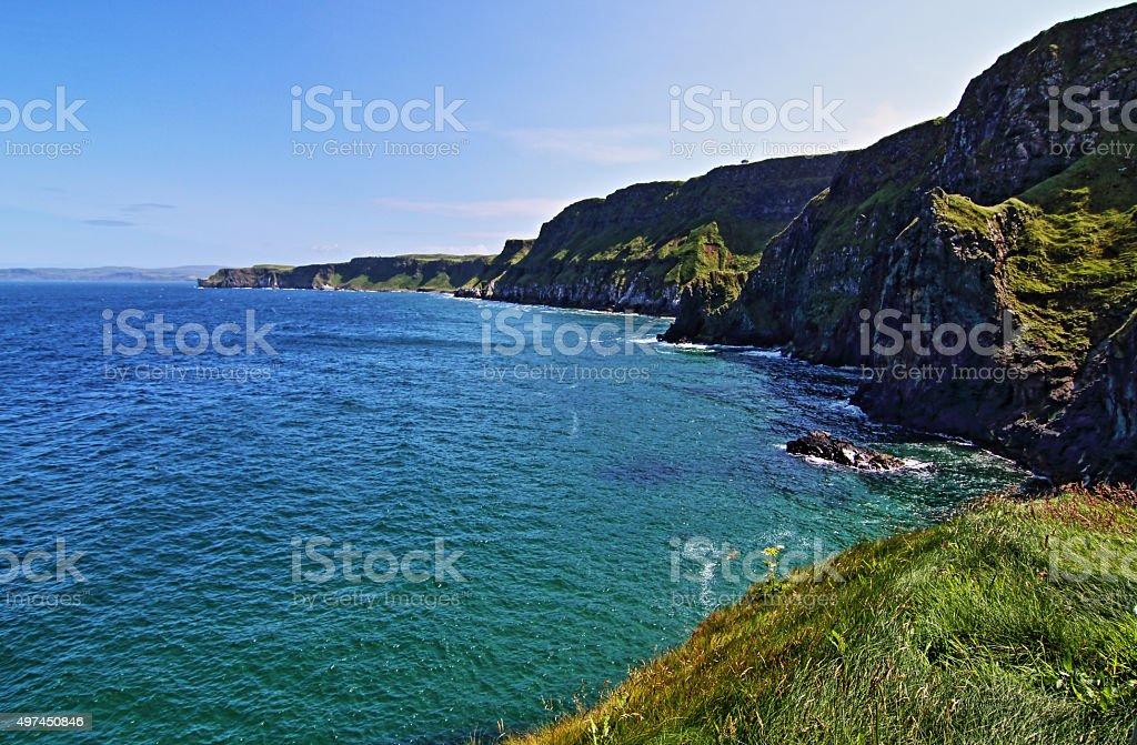 Cliffs along Irish Coast next to tiny Carrick-a-rede island stock photo