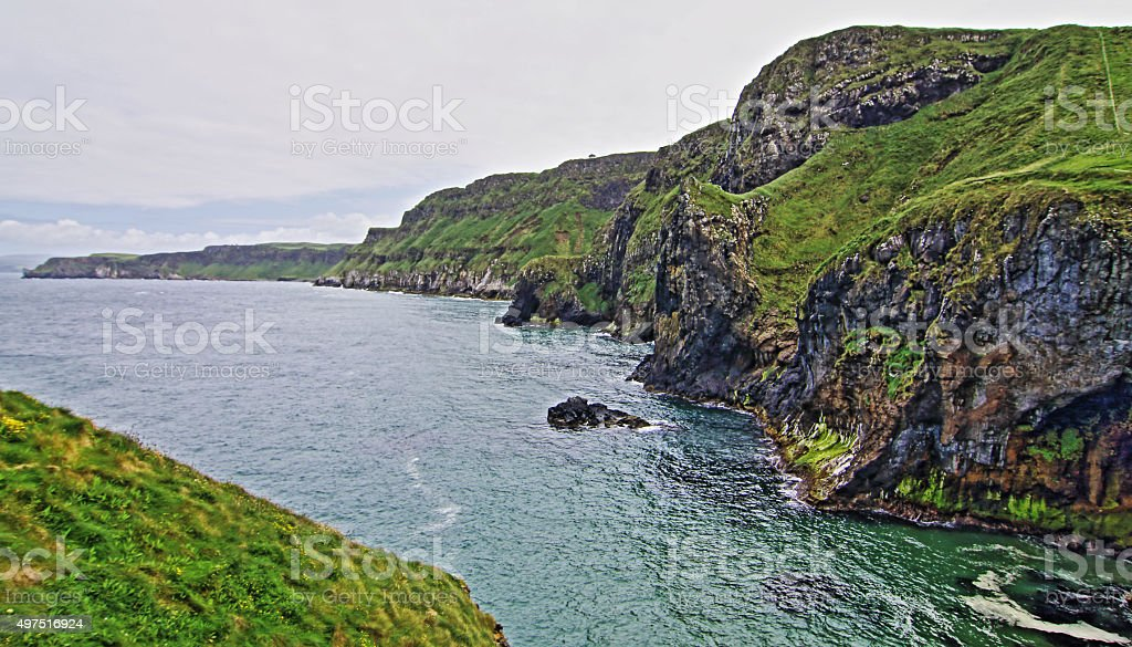 Cliffs along Irish Coast seen from tiny Carrick-a-rede island stock photo