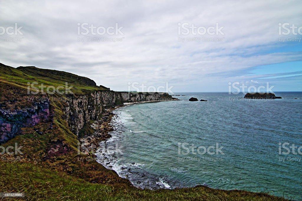 Cliffs along Irish Coast under overcast clouds stock photo