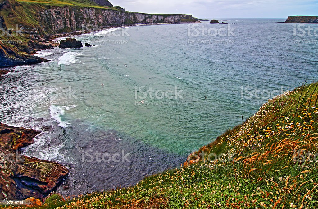 Cliffs and bay along Irish Coast next to Carrick-a-rede island stock photo