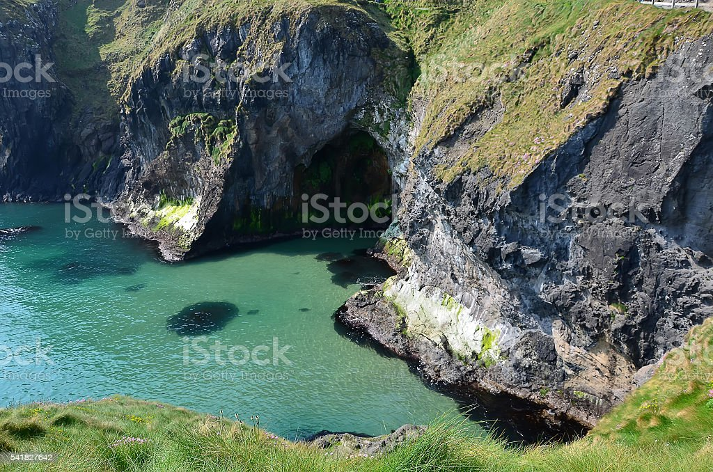 cliffs and coast above the sea in northern Ireland stock photo