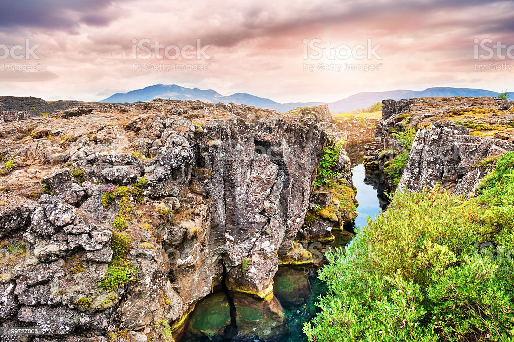 Cliffs and deep fissure in Thingvellir National Park, Iceland stock photo