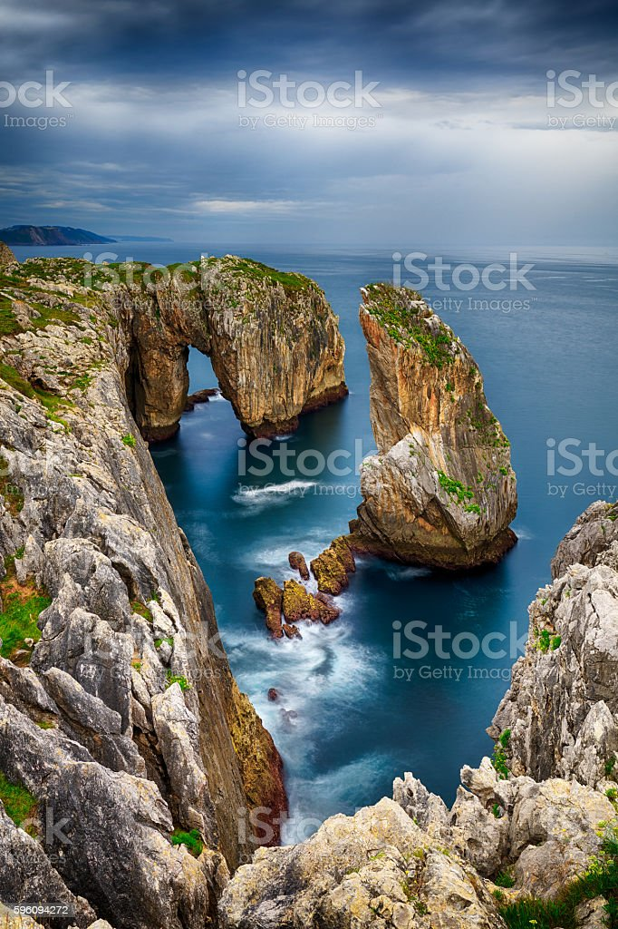 Cliffs and islets in the Cantabrian coast royalty-free stock photo