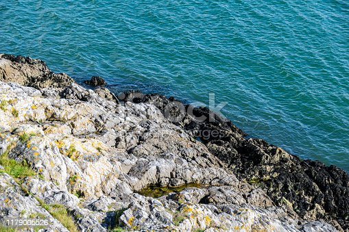 Cliffs and rock formations into the Atlantic Ocean and English Channel in Plymouth, Devon, UK