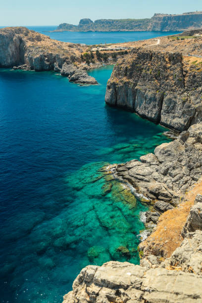 Cliffs and St. Paul's Bay, Rhodes island, Greece stock photo
