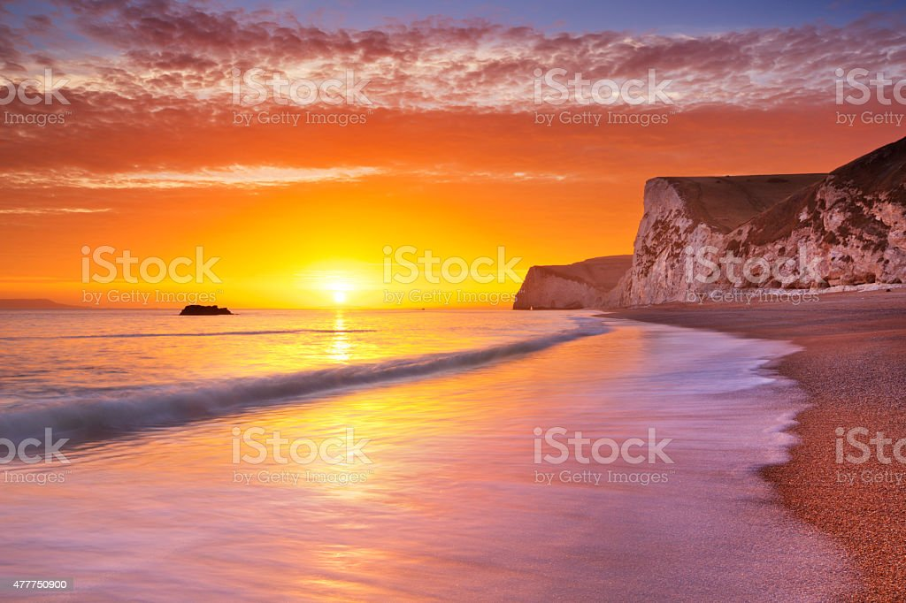Cliffs at Durdle Door beach in Southern England at sunset stock photo