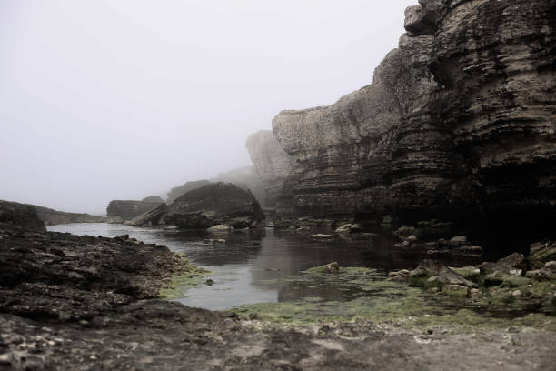 Cliffs Foggy and Sea stock photo
