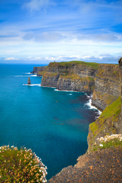 cliffs near a mass of water in moher, ireland - cliffs of moher stock pictures, royalty-free photos & images