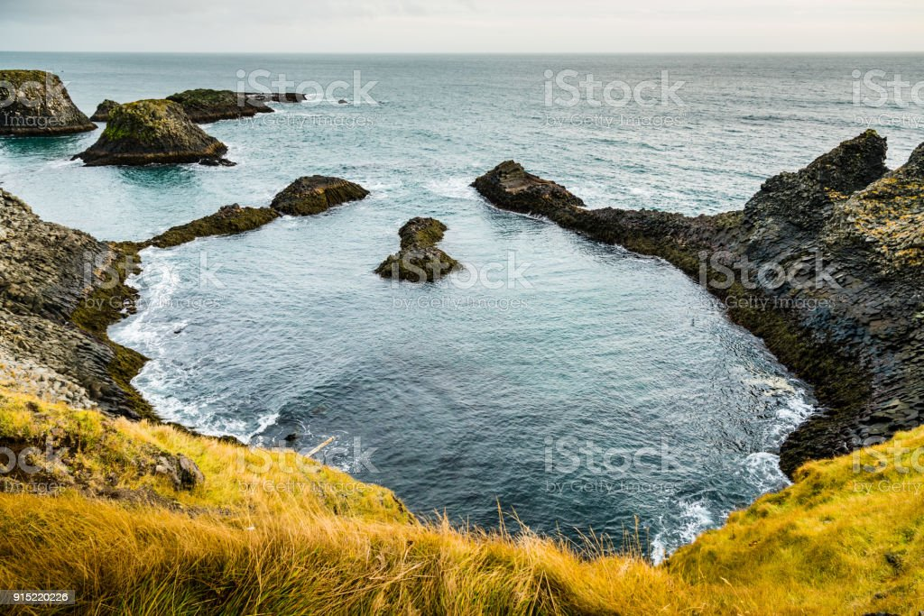 Cliffs of Arnarstapi -  Beautiful Formations of Coastline in Iceland stock photo