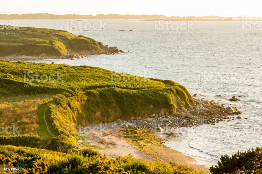 cliffs of Creac'h Maout in the evening light stock photo