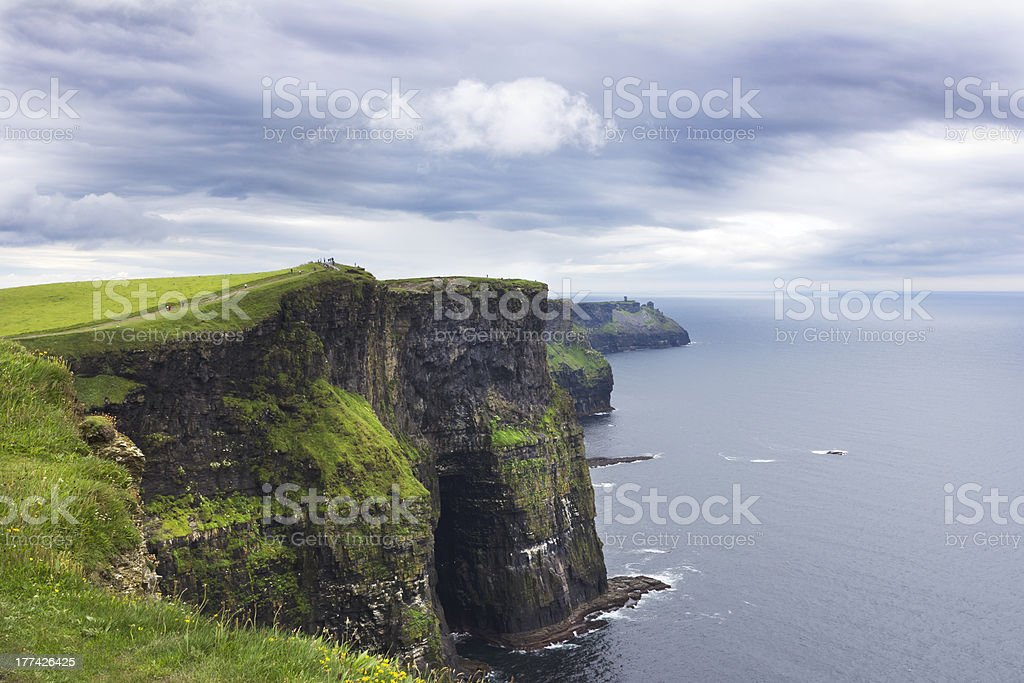 Cliffs of Moher and Distant Ruins stock photo