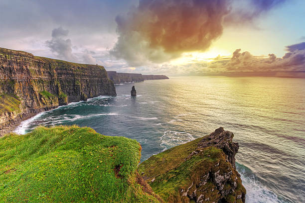 cliffs of moher at amazing sunset - cliffs of moher stock pictures, royalty-free photos & images