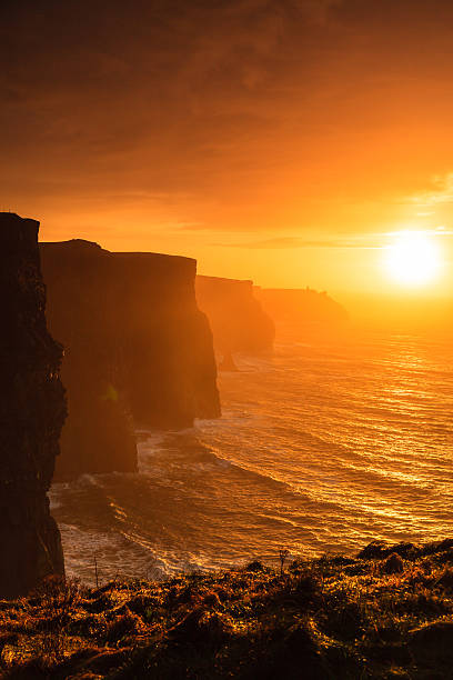 cliffs of moher at sunset in co. clare, ireland europe - cliffs of moher stock pictures, royalty-free photos & images