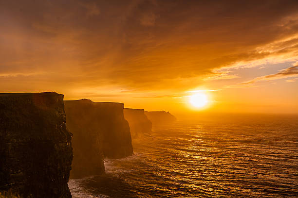 Cliffs of Moher at sunset in Co. Clare, Ireland Famous cliffs of Moher at sunset in Co. Clare Ireland Europe. Beautiful landscape natural attraction. cliffs of moher stock pictures, royalty-free photos & images
