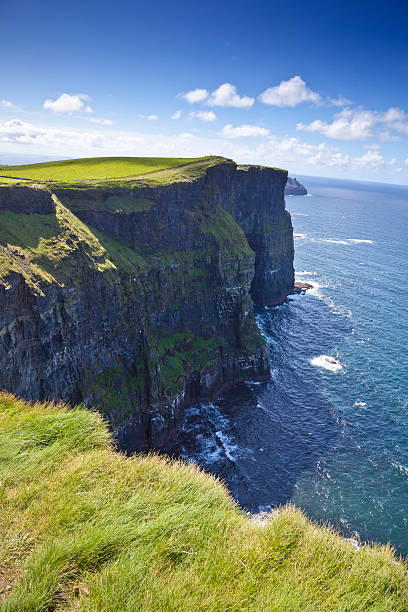 cliffs of moher in a sunny day - cliffs of moher stock pictures, royalty-free photos & images