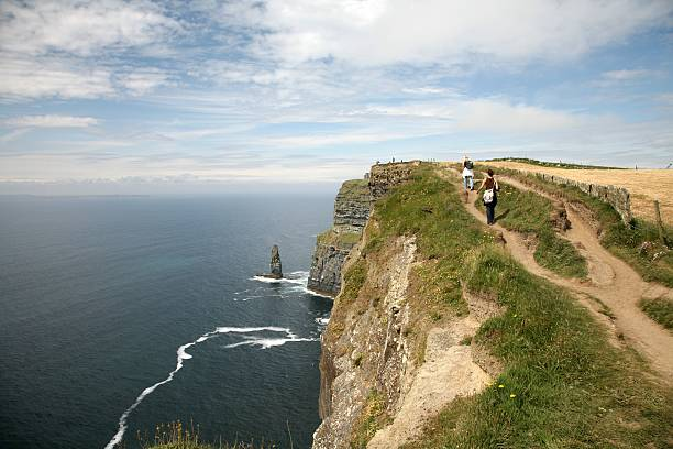 cliffs of moher walking - cliffs of moher stock pictures, royalty-free photos & images