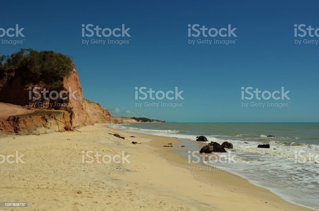 Cliffs, tourism and beautiful beach stock photo