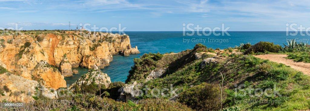 Cliffs view by Atlantic Ocean, Lagos, Algarve, Portugal. stock photo