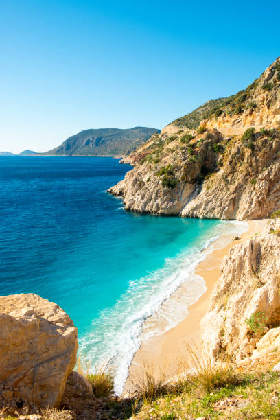 clifftop view nobody sand beach kaputas turkey - турция стоковые фото и изображения