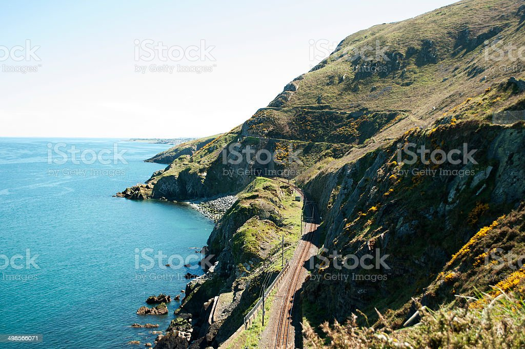 Cliffwalking Between Bray and Greystone, Ireland The Cliff Walk is a linear walk between Bray and Greystones, following the train line along the cliffs of Bray Head. This well maintained walk offer stunning and dramatic views along steep cliffs into the Irish Sea.  Take one of the many trains to get back to your starting point . Adventure Stock Photo