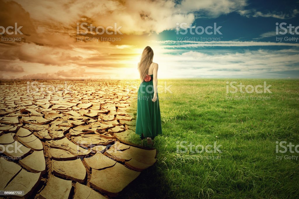 A Climate Change Concept Image. Landscape of a green grass and extreme dry drought land stock photo