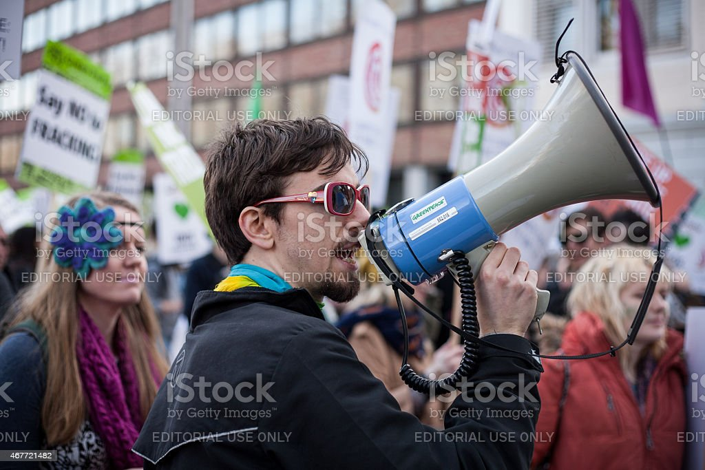 Climate change demonstrator uses megaphone stock photo