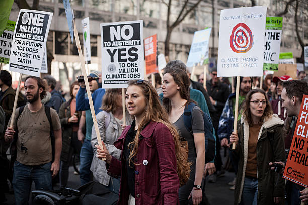 Climate change demonstrators march in central London stock photo