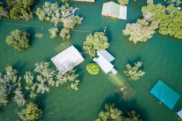 Climate Change Floods leaves houses under water and Destroyed stock photo