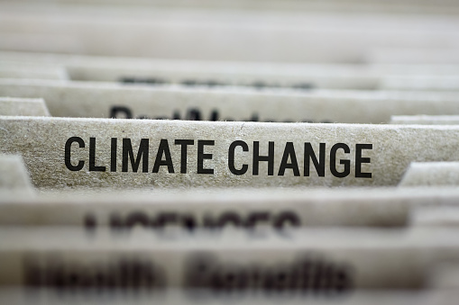 File folder tab for Climate change files with shallow DOF and focus on label