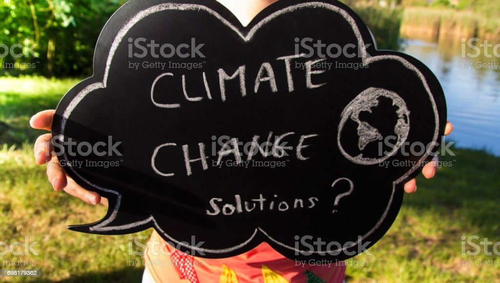 Climate change solutions text stock photo