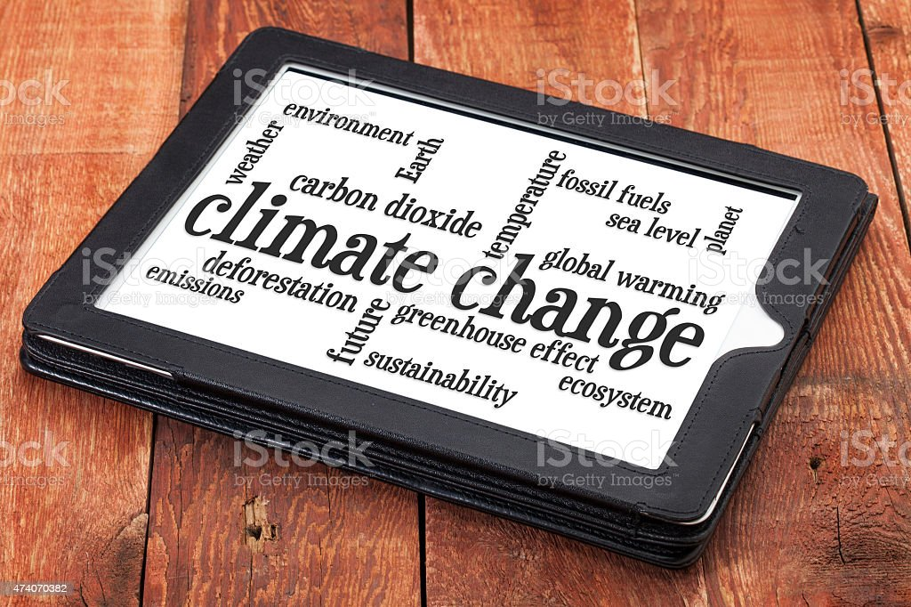 climate change word cloud on tablet stock photo