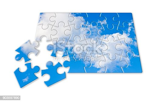 istock Climate changes concept image with a cloudy sky in puzzle shape 903597890