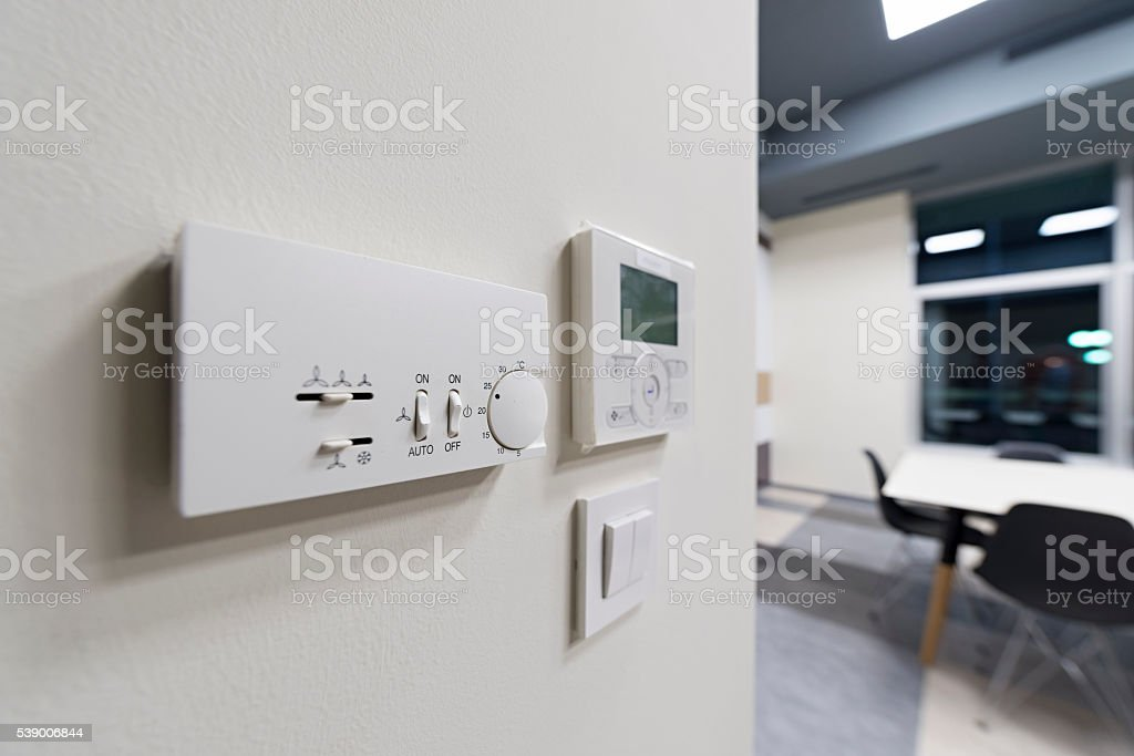 Climate control on office wall, selective focus stock photo