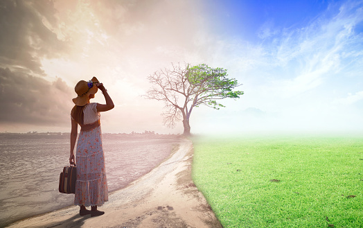 Woman standing between climate worsened with good atmosphere