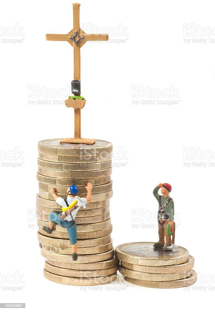 Climb on tower of money - Gipfelkreuz stock photo