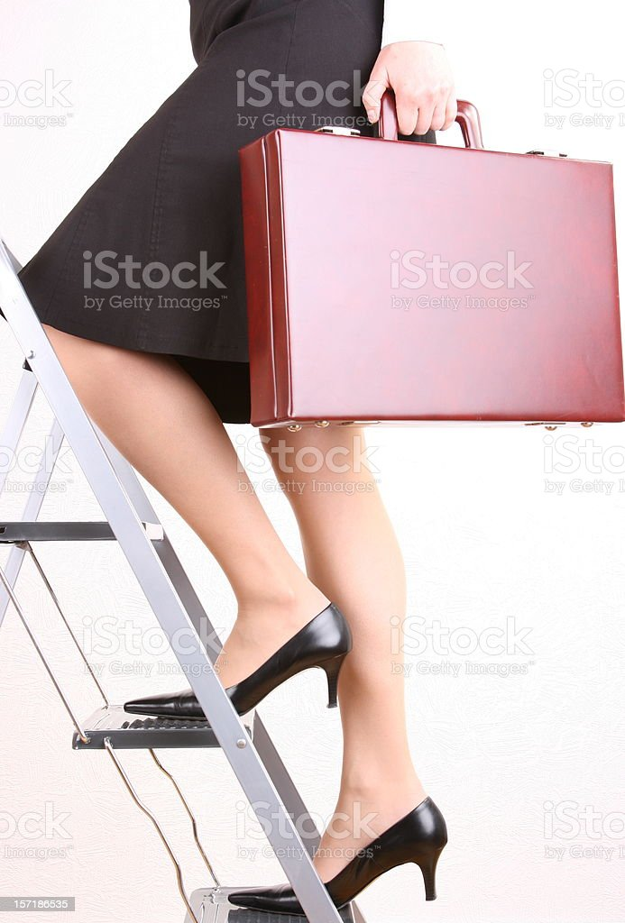 Climb the Ladder Woman royalty-free stock photo