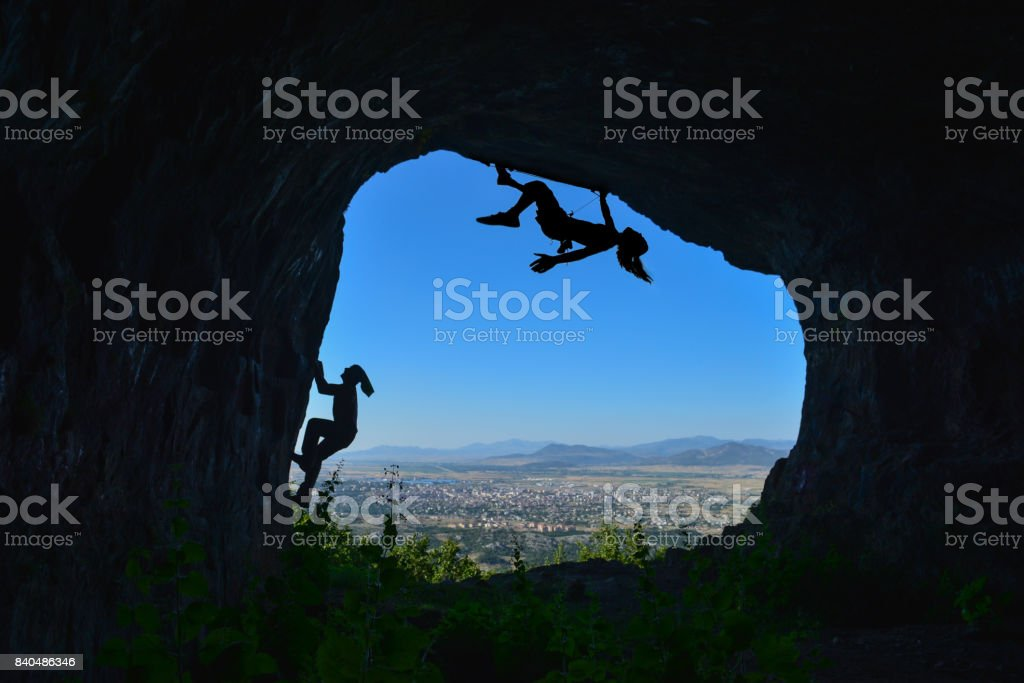 Climb to the cave ceiling stock photo