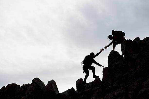 Climber Assist stock photo
