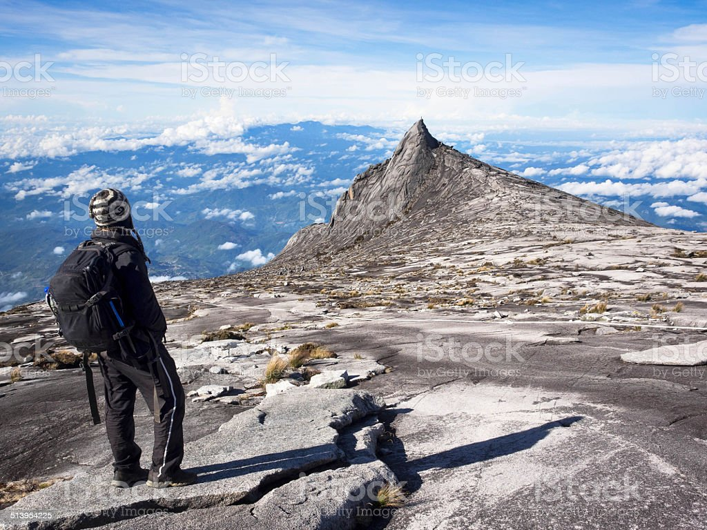 Climber at the Top of Mount Kinabalu, Sabah, Malaysia stock photo