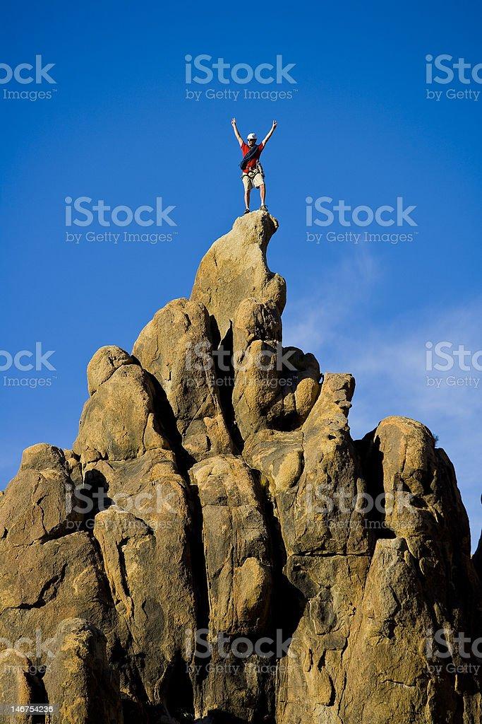 Climber celebrates on the summit. royalty-free stock photo